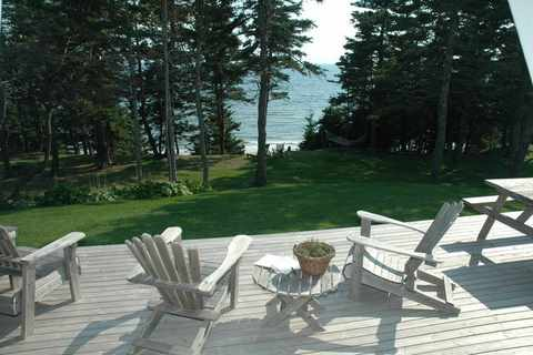 muskoka chairs by the ocean